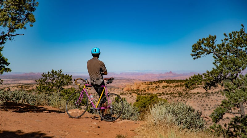Chip Thomas enjoys the view at a canyon near his home outside of Shonto, Arizona.