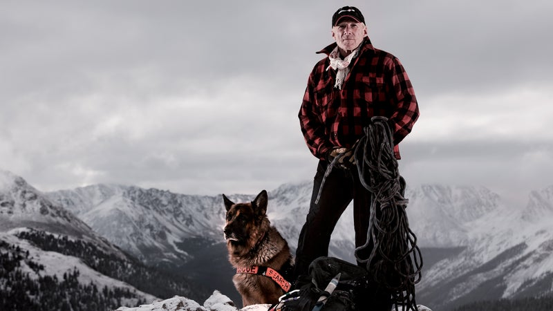 Ferrara with his German Shepherd, Lhotse, at the top of Colorado's Independence Pass