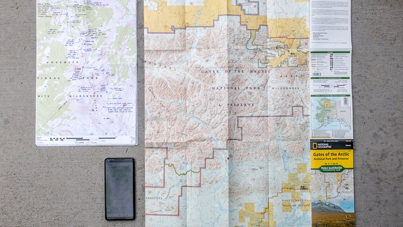 My three standard map types (clockwise from top left): custom-detailed maps on 11-by-17-inch paper, a commercial overview map, and digital maps and layers on a smartphone