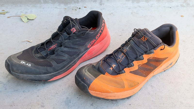 The X Alpine Pro fits most similarly to the original S-Lab Sense Ultra (left). Both share a generous rounded toe box and secure fit in the heel and midfoot.