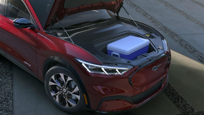 With no engine taking up space, there's room under the hood for storage. The Mach-E's frunk includes a drain plug.
