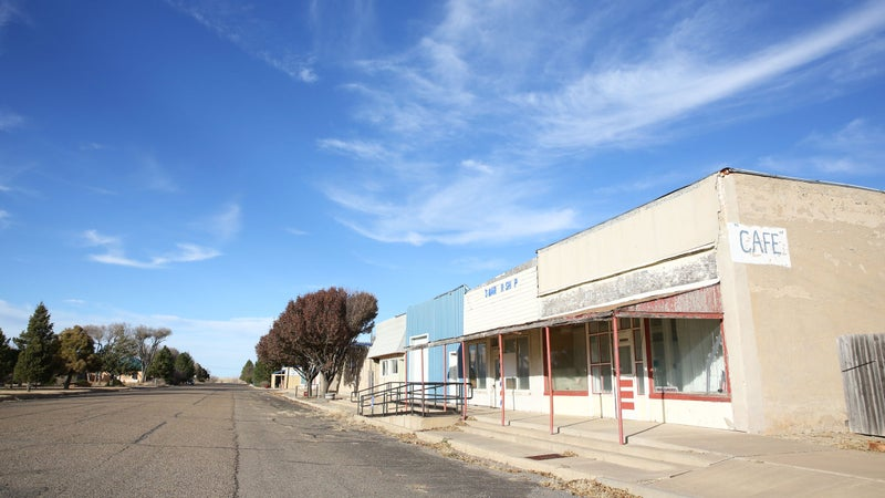 Some shops in Roy sitting vacant under the clear blue New Mexican sky. Most places in town are closed on Sundays.