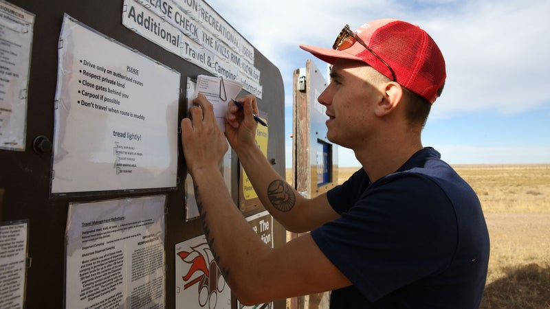 A climber filling out the land-usage survey at the Smokey Bear sign at the entrance to Mills Canyon. If you're visiting, make sure to stop and let the Forest Service know why you're there and what amenities you'd like to see in the future.
