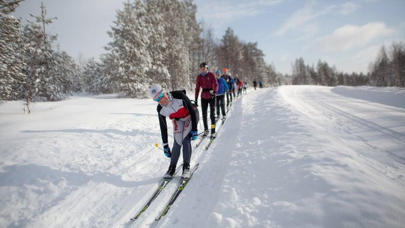 A group skiing near the Virkkula service point in Kuusamo, Finland