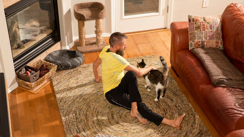 At home, with one of his rescue cats