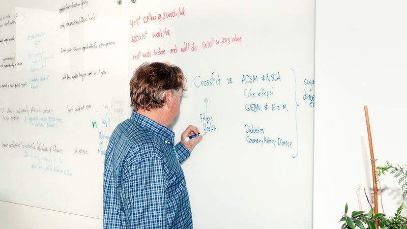 Glassman writing on a whiteboard
