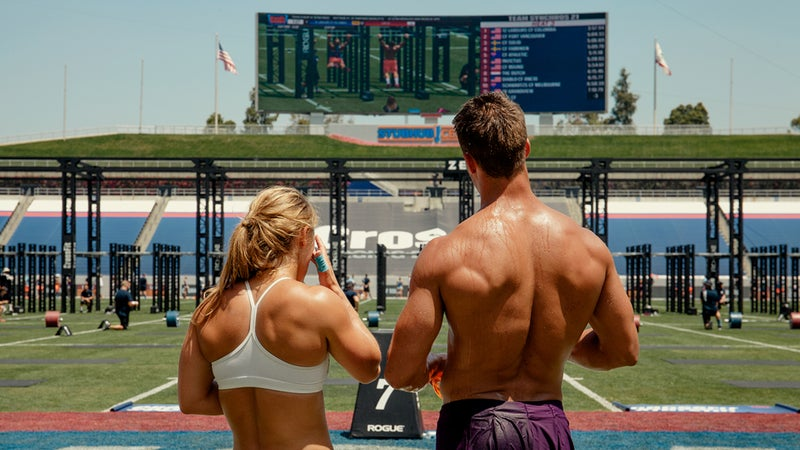 Two athletes study the field at the 2015 CrossFit Games.