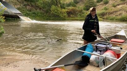 Mel packing the canoe