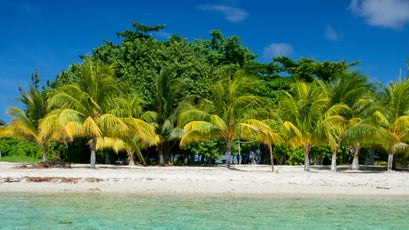 An idyllic beach at Hunting Caye in the Sapodilla Cayes Marine Reserve.