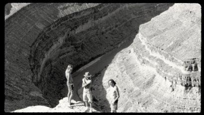 The author (center) and two friends at Goosenecks State Park in 1990