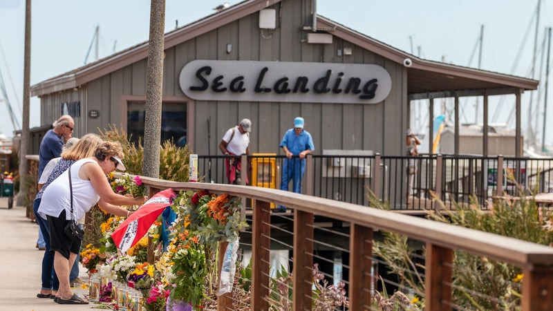Mourners leaving flowers and memorabilia at the Sea Landing dock, home of the commercial dive boat Conception, in Santa Barbara on September 3, 2019