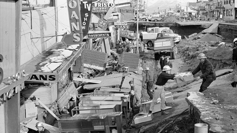 Small business owners clear salvagable items and equipment from their earthquake-ravaged stores on Fourth Avenue in Anchorage, Alaska, in the aftermath of the 1964 earthquake.