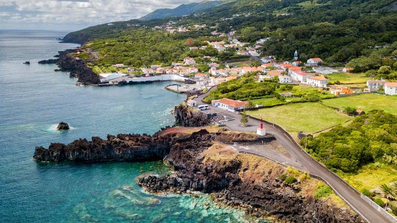 Aerial shot of the beautiful blue waters next to Canada de Africa on Sao Jorge, Azores, Portugal.