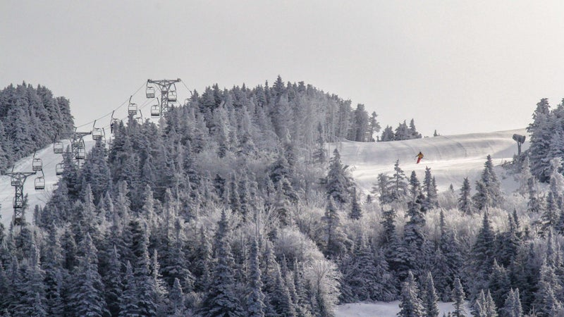 A skier coming down Saddleback Mountain before its closure in 2015