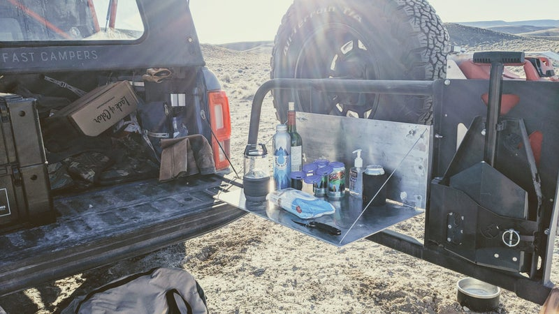 The reality of camping isn't often perfectly curated, immaculate campsites. Arrive at night, in the cold, and you'll typically end up with a scene like this one. The table kept important items out of the way, in a stable, safe place, even in the dark.