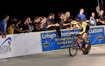 The author giving high fives to friends watching from the rail after winning a Keirin event at the Valley Preferred Cycling Center in 2017