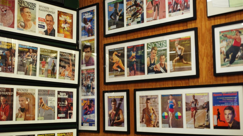 A wall inside Coogan's, displaying Sports Illustrated covers of track and field athletes.