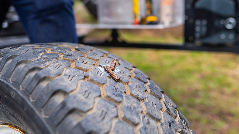 The plug should remain in the tire when you yank the tool out. Now just trim off that excess length.