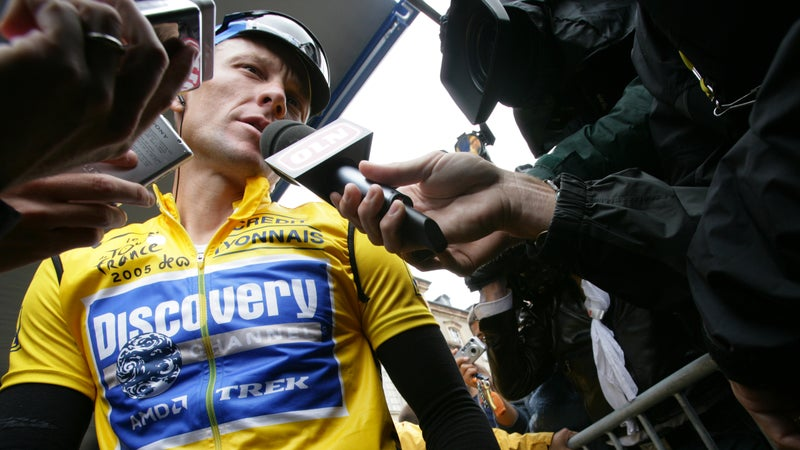 Armstrong talking to media during the 2015 Tour de France