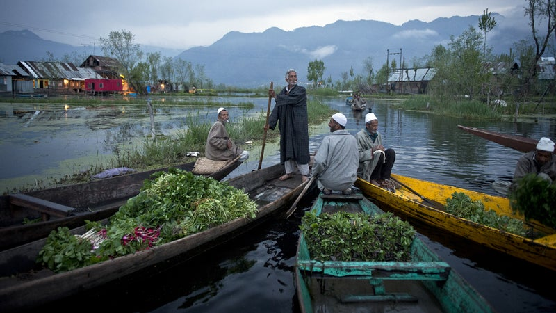 Kashmiri men sell their vegetables at a floating market on the picturesque Dal Lake in the summer capital of Srinagar, in the Indian-held state of Kashmir. Once a tourist hot spot, the only visitors to this magnificent landscape these days are Indian soldiers.