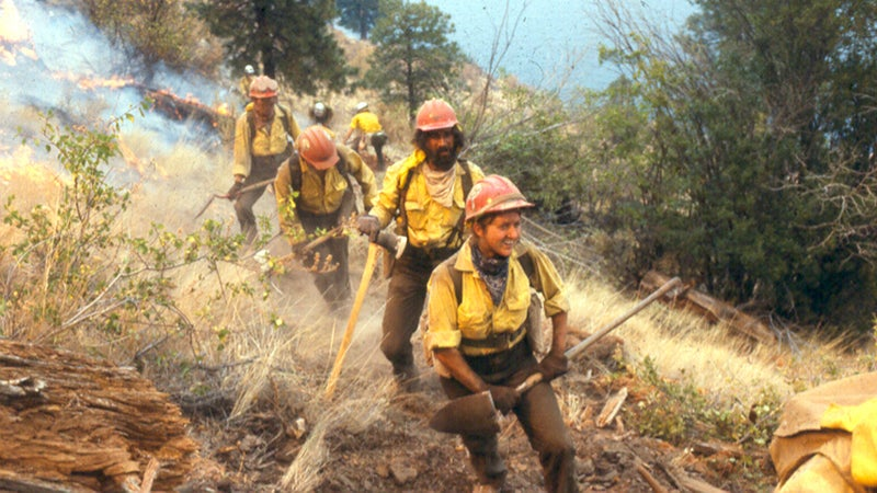 Danah Feldman leads her squad on a fire in the late 1970s while working as a squad boss for the Baker River Hotshots.