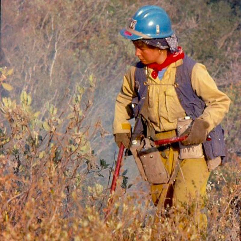Sue Husari lights brush during a burnout operation in California in 1977.