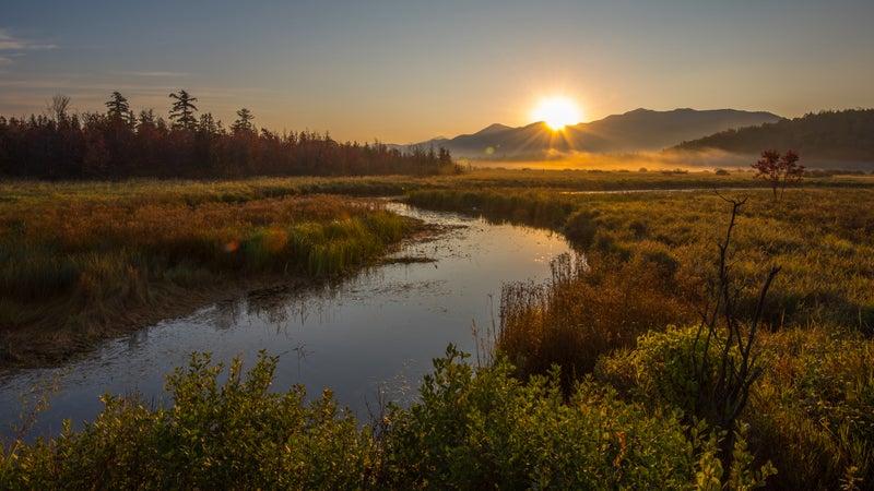 Sunrise over McKenzie Mountain as seen from the Saranac River in Saranac Lake, New York, the Adirondacks