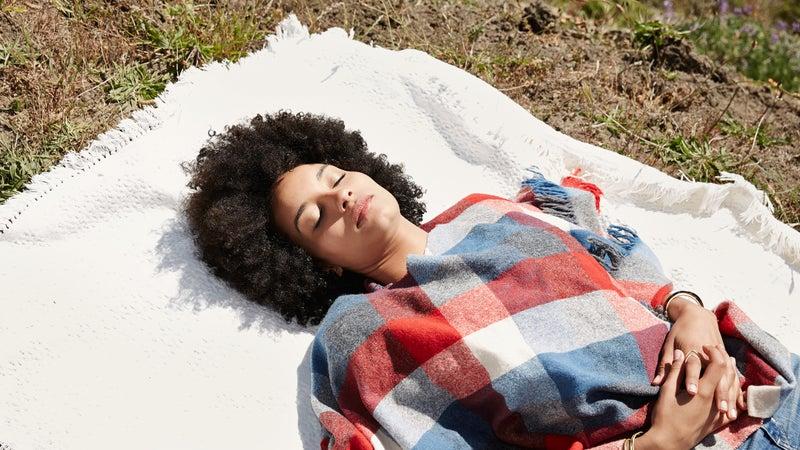 Mixed Race Millennial Woman Sleeping In Nature