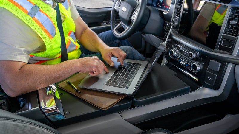 This fold-down table turns the center console into an actual work table, too.