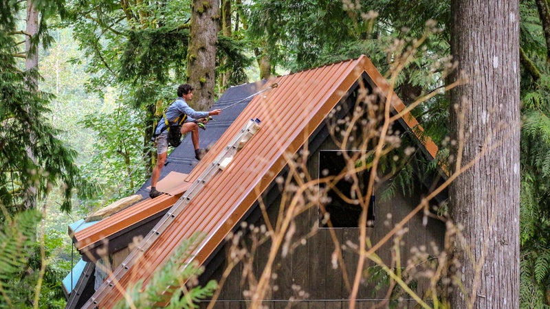 Bryan Schatz on top of the cabin he built with Patrick (Pat) Hutchison in Washington's Cascade Mountains in 2018