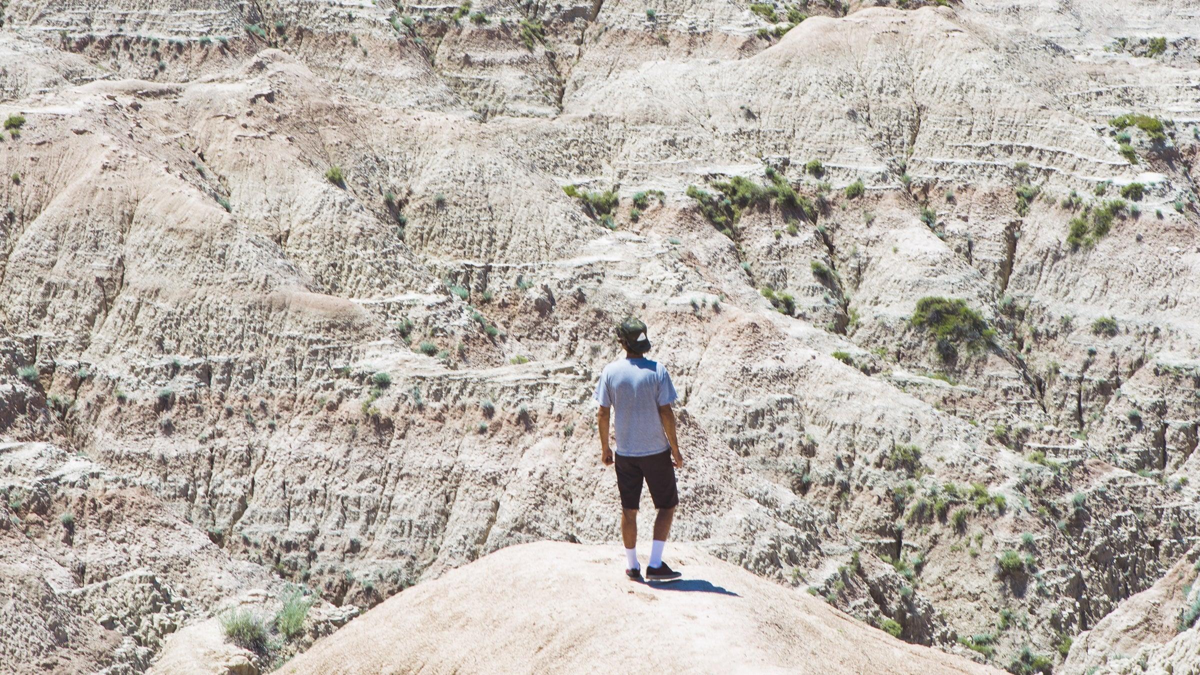 Man Standing Amongst Natural Plateaus