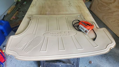 We traced the outline of the mud mat onto the plywood for a tight fit.