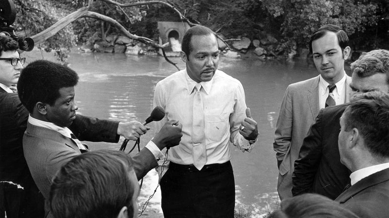 Cleveland mayor Carl Stokes giving a press conference on the banks of the Cuyahoga on June 23, 1969