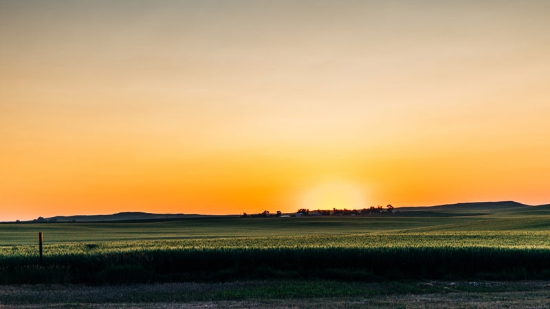 Sunset at an agriculture field in rural North Dakota farm