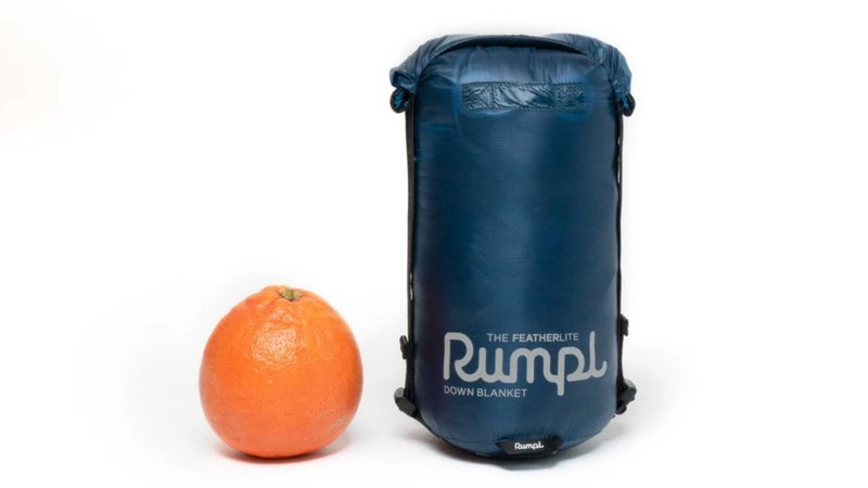 Rumpl's new Featherlite blanket packs down small enough to fit in a purse or a backpack with ease yet offers appreciable, versatile weather protection.