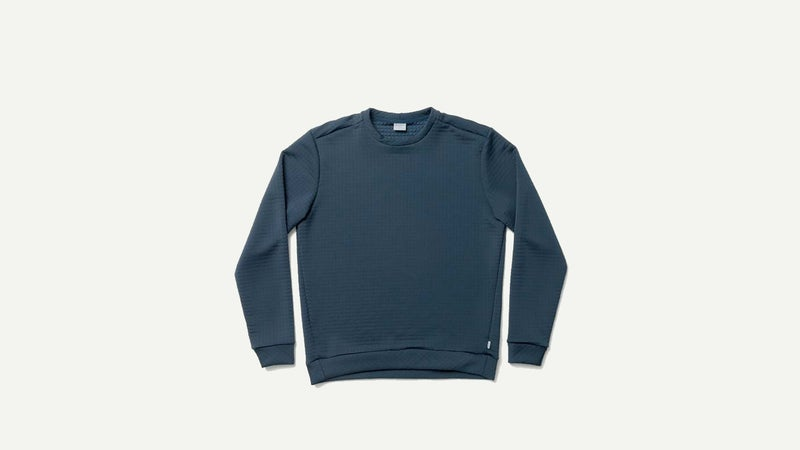 This looks like a normal crewneck sweater, but it's made from Polartec Power Air, a fleece material that sheds few fibers and moves easily when layered under other garments.