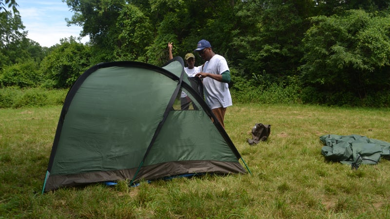 Part of the program is learning camping skills, like setting up a tent.