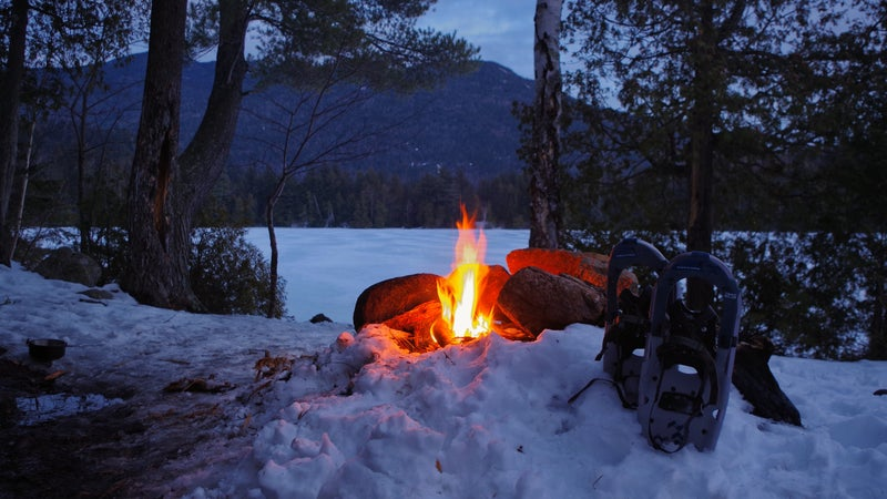 Winter Campfire on Copperas Pond with Snow Shoes in the Adirondack Mountains of Upstate New York.