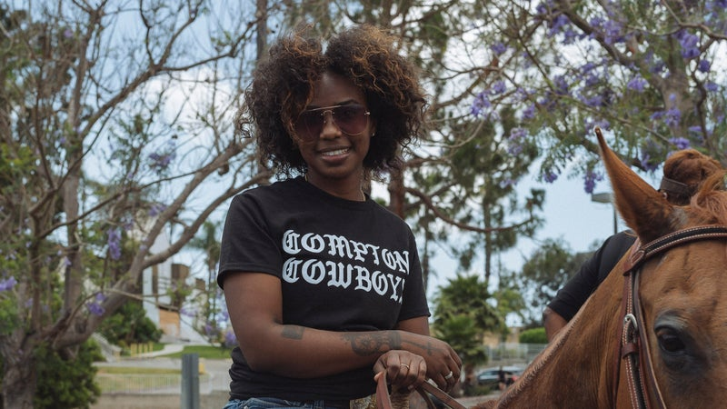 Keiara Wade participates in the Compton Cowboys Peace Ride, organized as a show of solidarity for the black community in Los Angeles and Compton, Calif., June 7, 2020.  (Kayla Reefer/The New York Times)