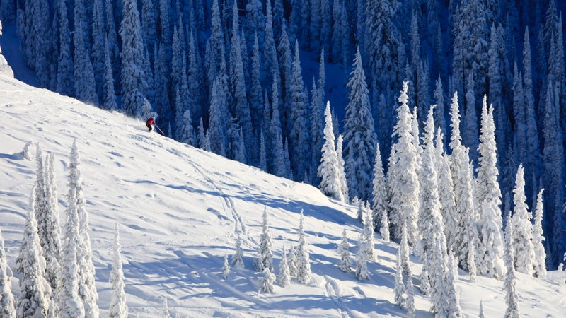 Skier On Snow Covered Mountainside