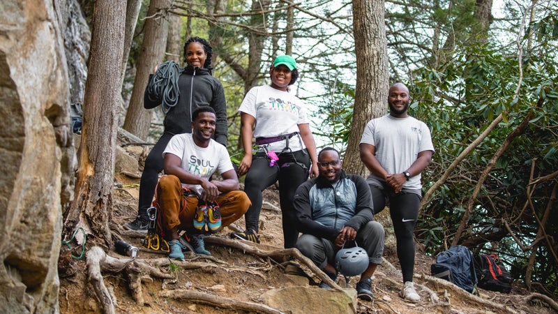 Tyrhee Moore (bottom left) and Soul Trak members during a rock climbing trip in the New River Gorge, West Virginia.