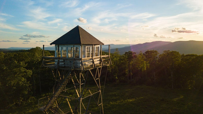 The Thorny Mountain fire tower faces a morning view of the mountains surrounding Seneca State Forest in West Virginia.