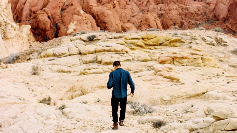 Young Man Walking In Valley Of Fire