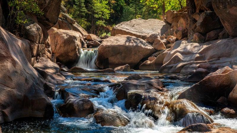 Waterfall on Cascade Highway 7 South Saint Vrain Creek near Rocky Mountain National Park in Autumn