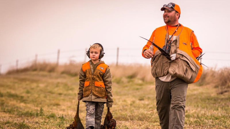 Sal Roseland and his son collecting birds