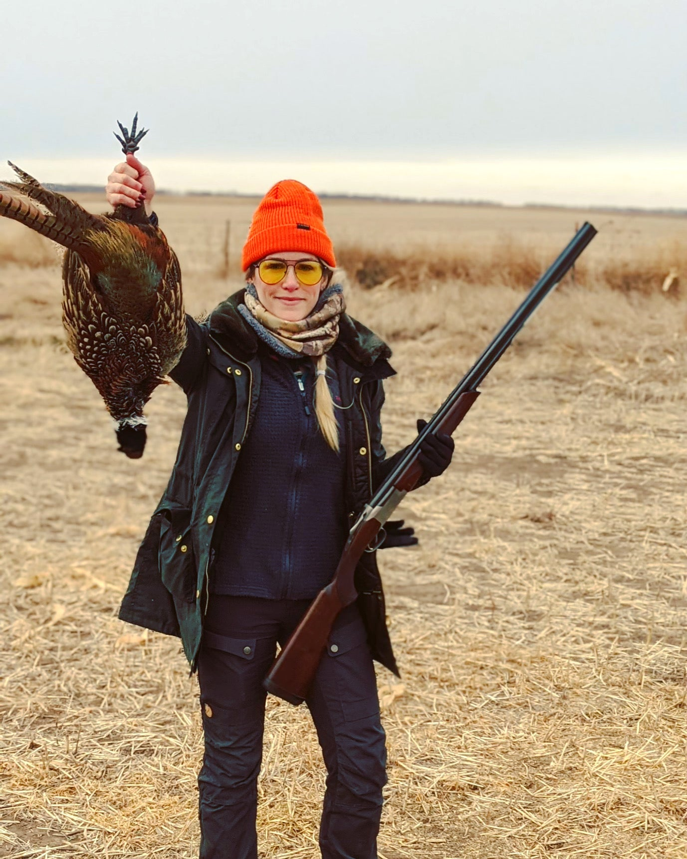 """Virginia's first pheasant. She's shooting a 20 gauge Browning Citori, which is a perfect fit for her 5'2"""" frame. Not only do over-under shotguns like this one look handsome, they're easier to load and unload than a semi-auto, offering neophyte hunters more confidence that they're being as safe as possible."""
