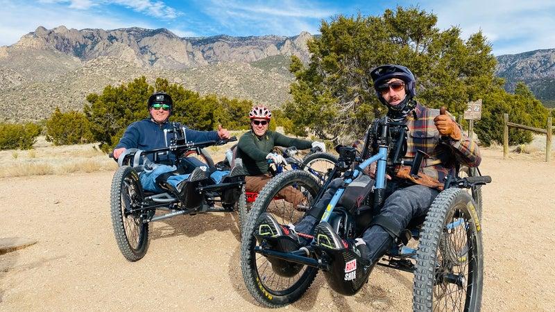 Berg (left) and friends mountain biking