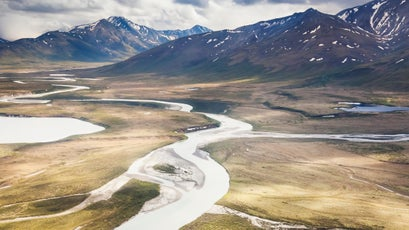 Aerial of the Noatak river flowing north out of the Brooks range, Gates of the Arctic national park, Alaska