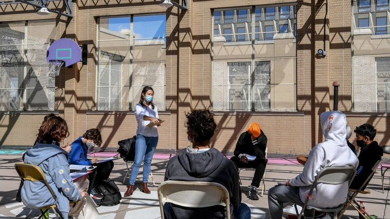Jane Collins teaches an interdisciplinary class of ninth and tenth graders on the rooftop of Essex Street Academy in Manhattan, Oct. 8, 2020. (Desiree Rios/The New York Times)
