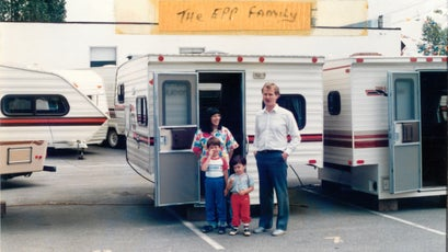 Epp (center) poses with his parents and brother at the Adventure Manufacturing plant, 1986